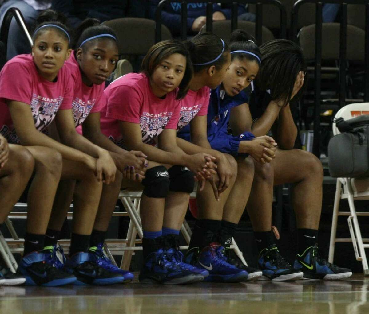 Dekaney's basketball team watches from the bench during the team's 69-31 loss to Duncanville in the state championship game March 3.