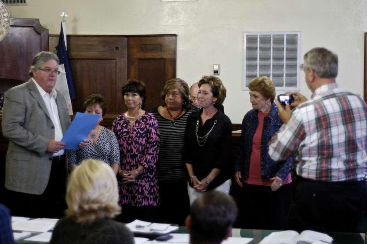 Proclaiming November Adoption Month in Liberty County, County Judge Craig McNair and representatives of