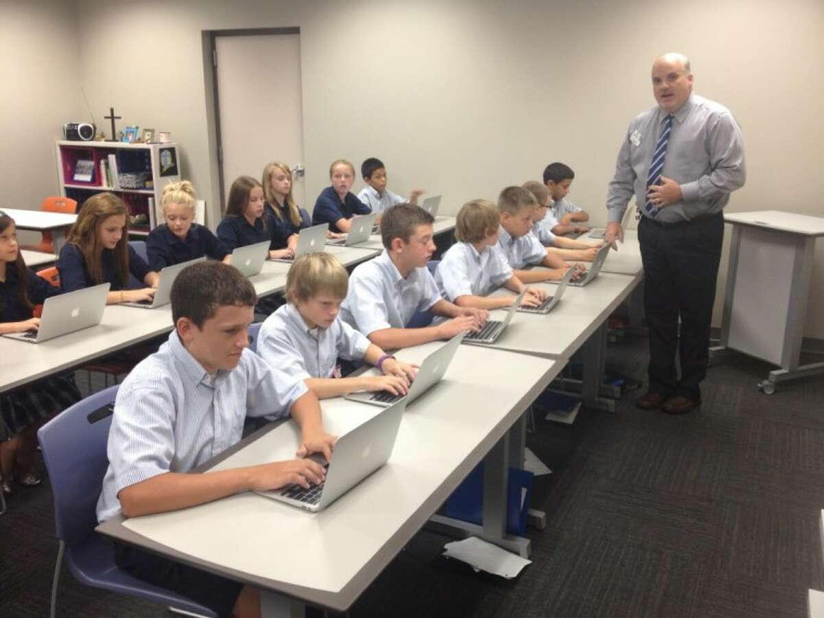 Steve McEwin, SLS director of technology, instructs students in his technology class on the first day of classes at Salem Lutheran School.