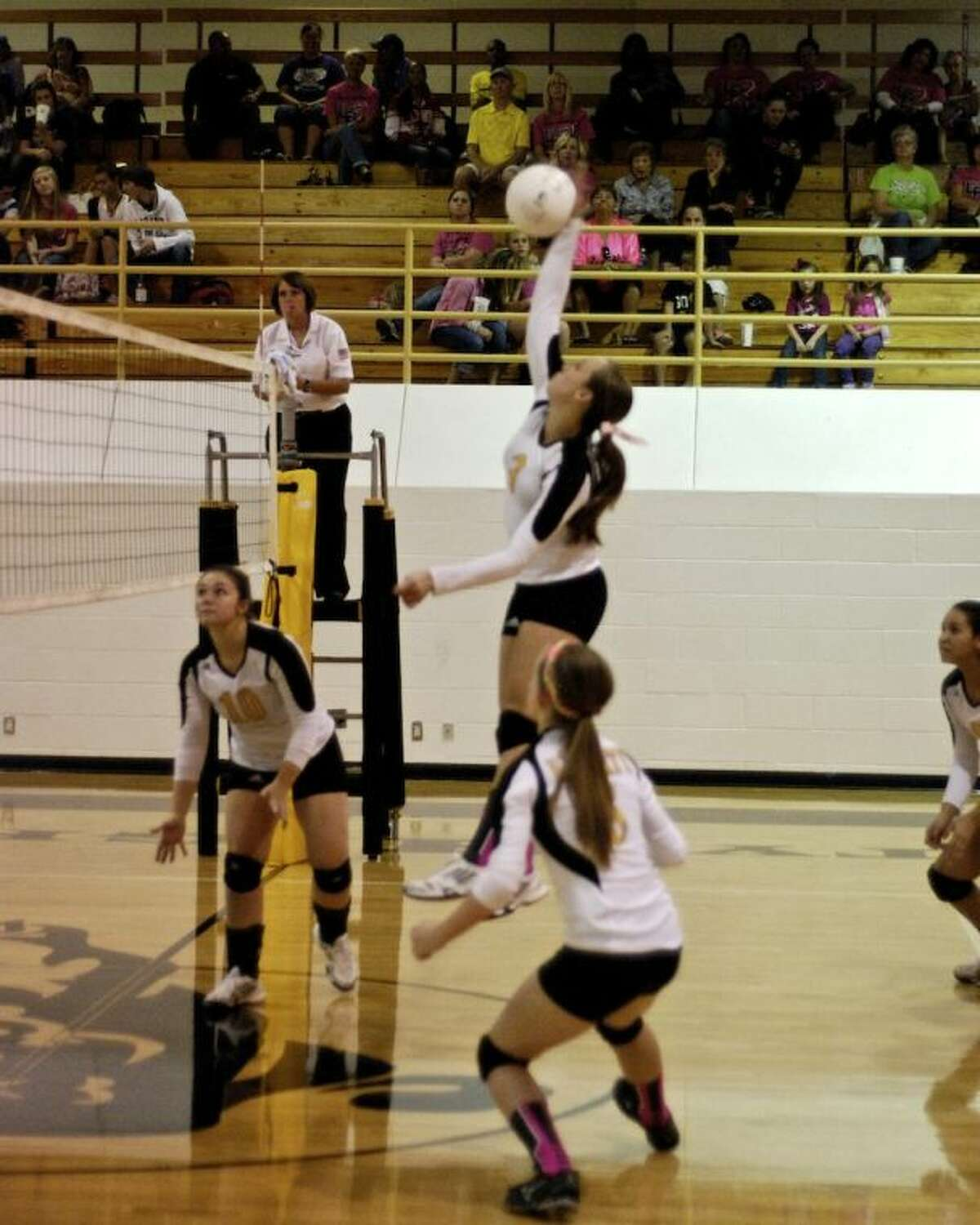 Kaitlyn Slack (3) attacks in Liberty's home game Friday, Oct. 25, against Coldspring.