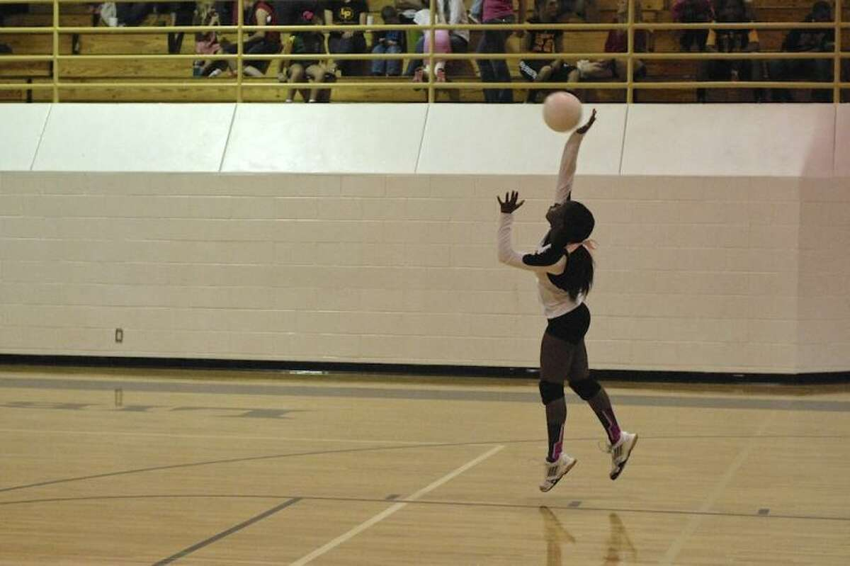 Liberty's Shilsa Rodgers (2) serves against Coldspring, Oct. 25.
