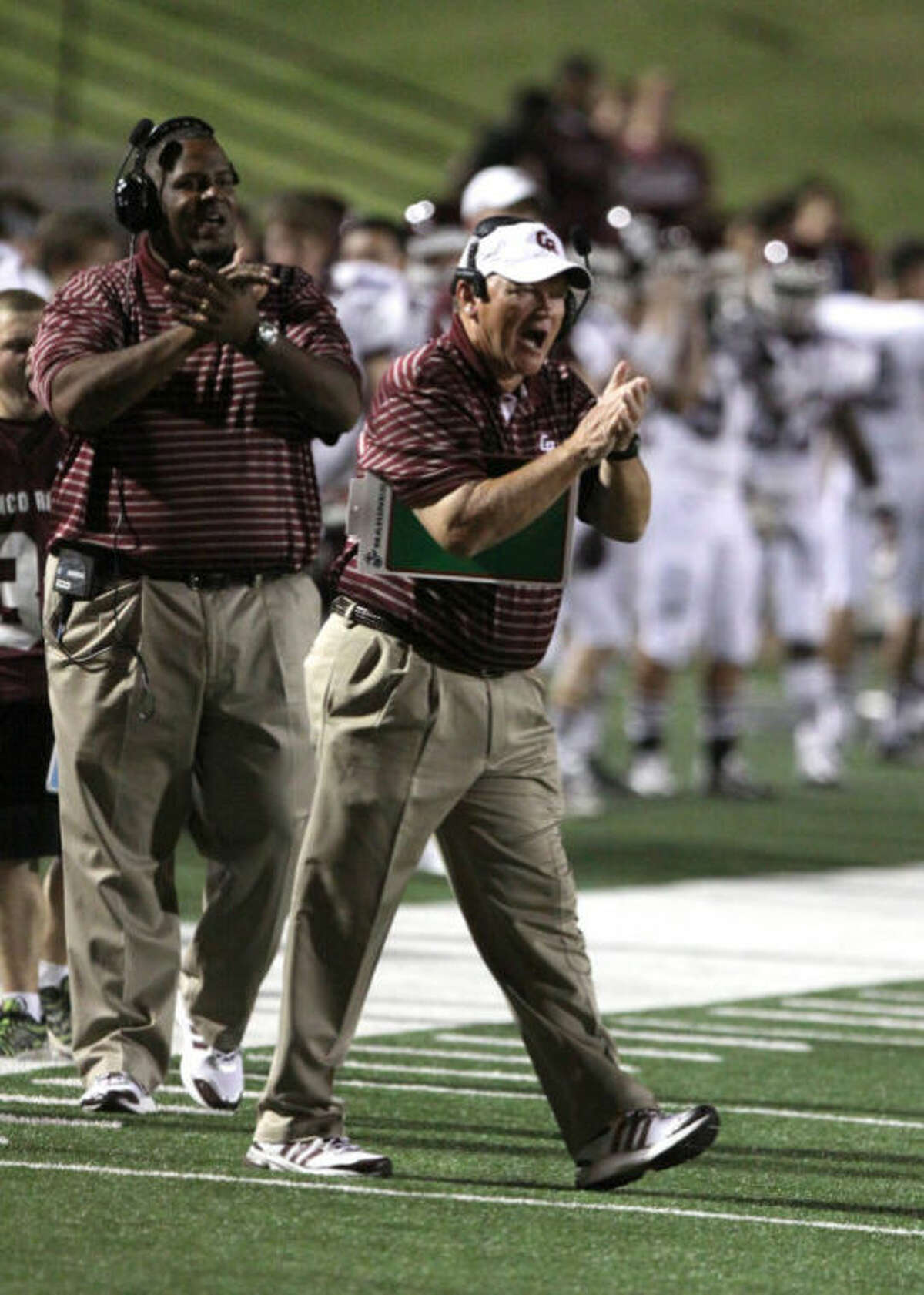 Cinco Ranch's Don Clayton cheers on his team against Memorial during their district game Sept. 26 at Tully Stadium. The Cougars take on undefeated Katy on Nov. 2 at Rhodes Stadium.