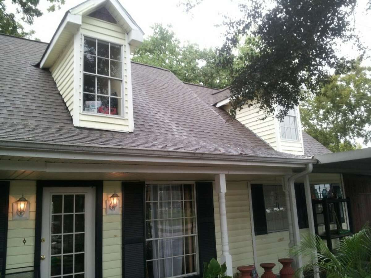 The ghost house on Fannin Street in Tomball - the upstairs window into the loft where the suicide took place.