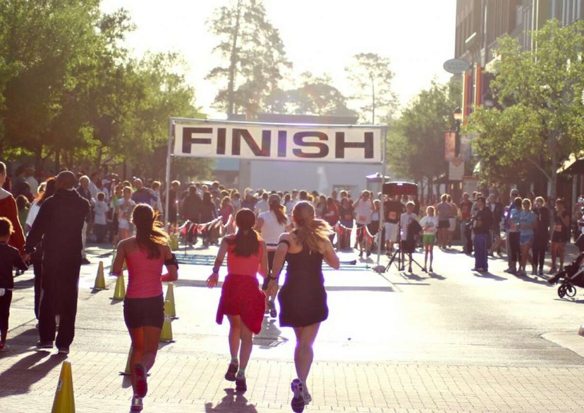 Runners head toward the finish line at last year's inaugural Run for Hope race, benefiting Camp Hope, a summer camp for area foster children. The second annual event will be held at Market Street in The Woodlands Saturday.
