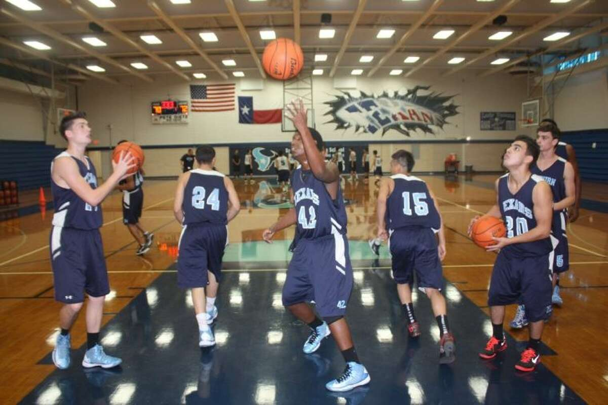 Sam Rayburn's players get busy with a drill during Wednesday's first official day of practice for the 2013-2014 season.