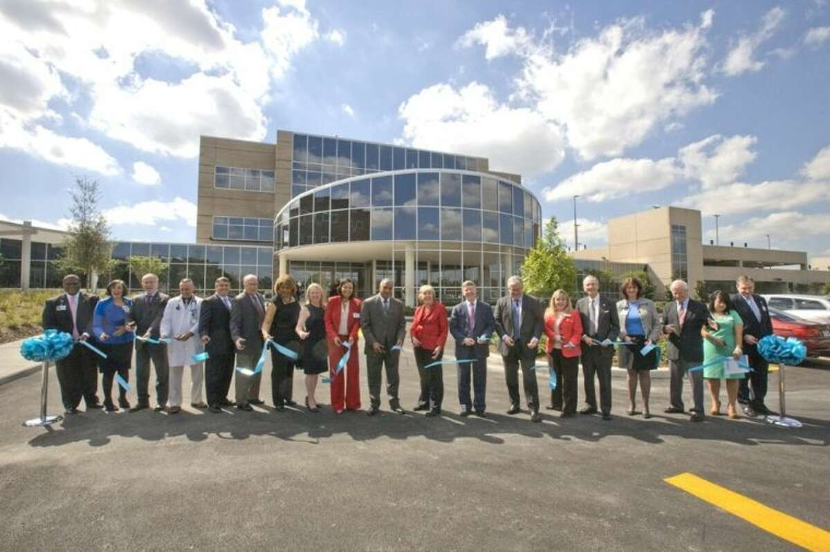 Harris Health Systems held a ribbon cutting ceremony for the new Outpatient Center at LBJ hospital. Pictured, left to right, are: Jessie Tucker III, administrator, Harris Health Lyndon B. Johnson Hospital; Dr. Carmel Dyer, chief of staff, Harris Health Lyndon B. Johnson Hospital/UTHealth; Dr. Giuseppe Colasurdo, president, UTHealth; Dr. Sebastian Tosto, medical director, Harris Health Outpatient Center/UTHealth; T.J. Tijerina, member, Harris Health Board of Managers; Michael Halpin, representative for U.S. Rep. Sheila Jackson Lee; Daisy Stiner, member, Harris Health Board of Managers; Anne U. Clutterbuck, member, Harris Health Board of Managers; Dr. Ericka Brown, administrator, Harris Health Ambulatory Care Services; Elvin Franklin Jr., member, Harris Health Board of Managers; Carolyn Truesdell, chair, Harris Health Board of Managers; Harris County Judge Ed Emmett; Dr. George Santos, member, Harris Health Board of Managers; Stephenie Pharr, director, Harris Health Outpatient Center; Harris County Attorney Vince Ryan; Ricci Sanchez, associate administrator, Harris Health Ambulatory Care Services; George V. Masi, chief operating officer, Harris Health System; Roxana Vasquez-Carrera, project manager, Harris Health Facilities Planning and Mark Sams, manager, Construction Operations, Harris Health Facilities Planning.