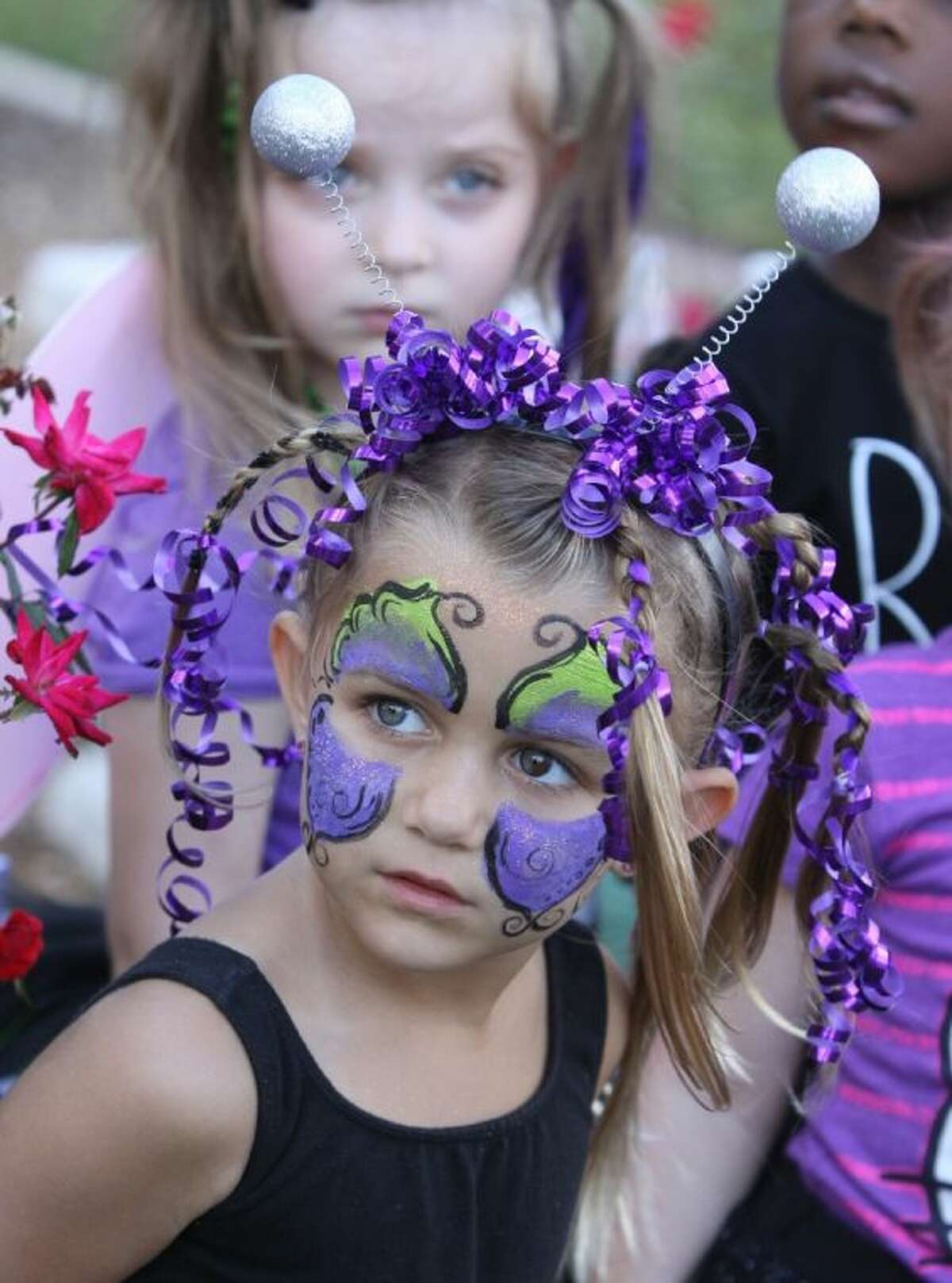 Caitlin Bloom, 4, gets ready to perform at the Pumpkin Patch at Holy Cross Episcopal Church in Sugar Land on Saturday, Oct. 26.