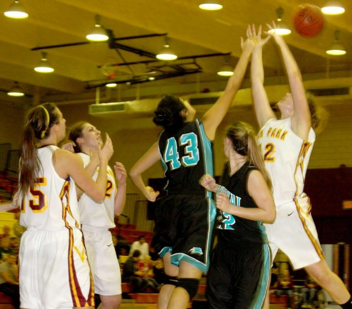 Deer Park's experience and size down low enabled the team to dominate Memorial in the rebounding battles during their contest Friday night that decided sole possession of first place heading into Round 2.