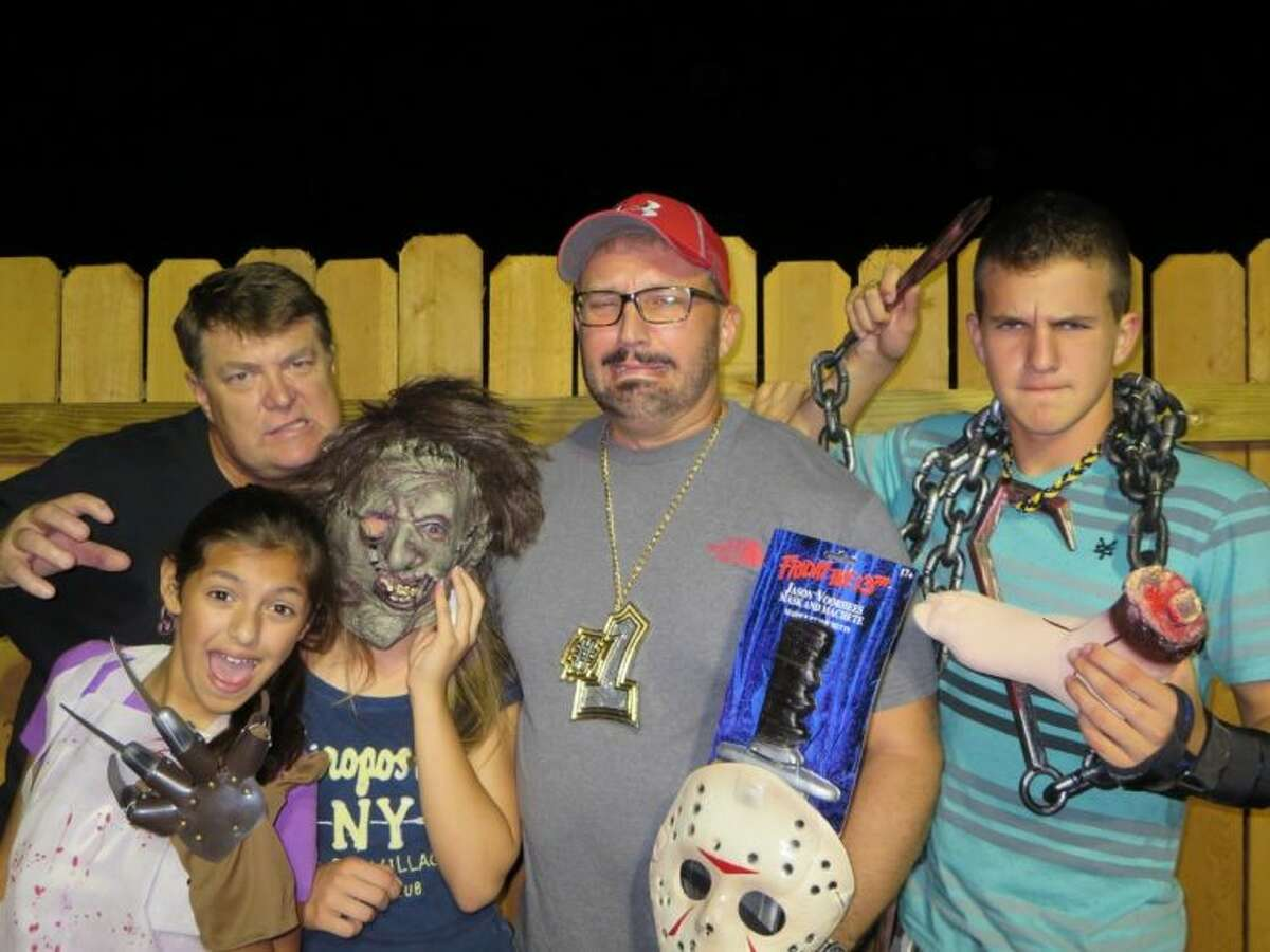 In back (from left) are ScreamWorld owner Jim Fetterly, one millionth SceamWorld customer Frank Dompnier and Ryan Dompnier. In front are Katia Sanchez and Amy Dompnier (in mask)
