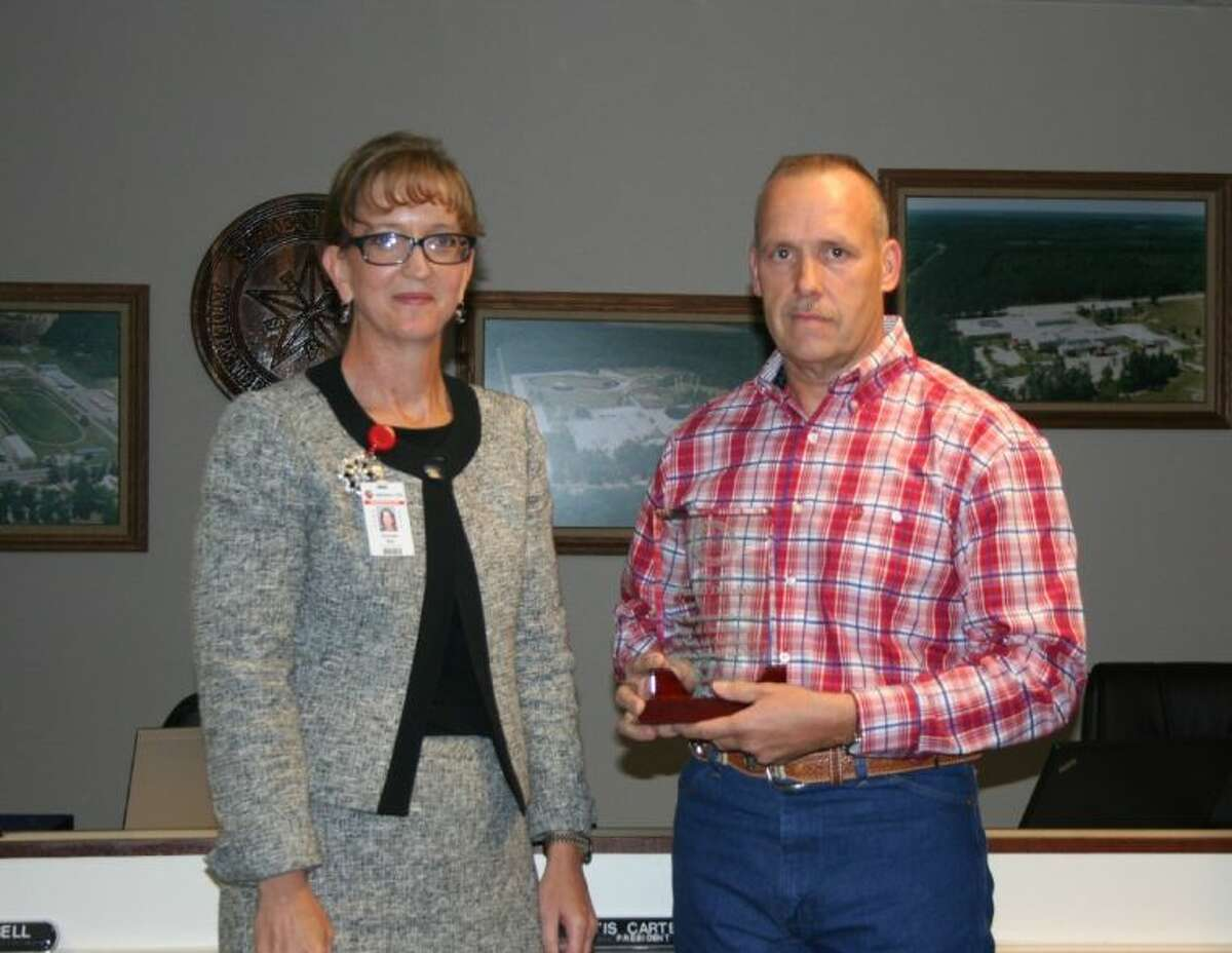 Splendora Superintendent Genese Bell presents school board member Dana Daniels, who has served as a member since 2001, with a plaque of recognition for his service. Daniels, along with current Board President Otis Carter, will be departing following this year.