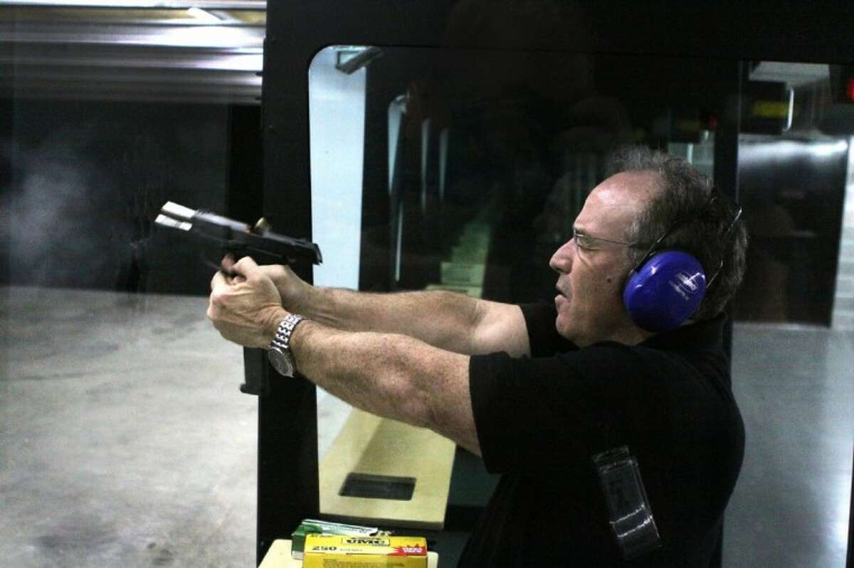 Photo by Alan Warren/The RancherCarl Lester of Katy shoots on the 25-lane indoor target range at Tactical Firearms in Katy.