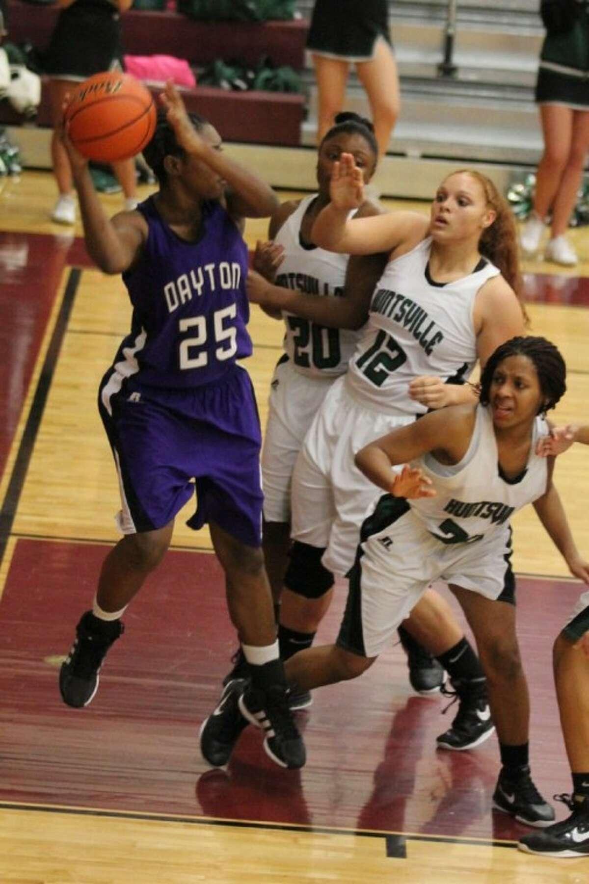 Jaleesa Miller makes a hustle play under the basket for Dayton.