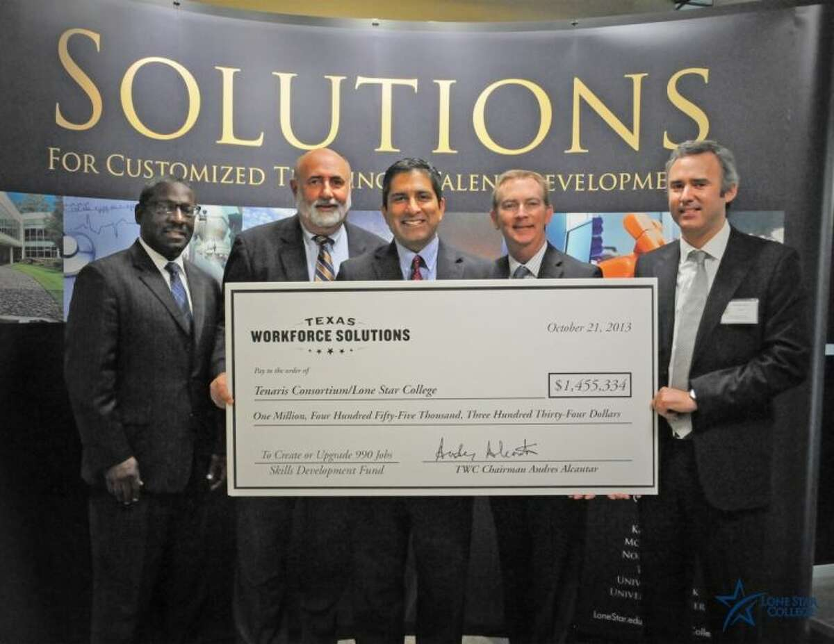 Pictured with the Texas Workforce Commission check are, left to right, Dale A. Robertson, director, Workforce Business Services Department, Skills Development Fund, TWC; Larry E. Temple, executive director, TWC; Andres Alcantar, commissioner, TWC; Rand Key, senior vice chancellor and chief operating officer, LSCS; and Horatio Galli, Tenaris University.