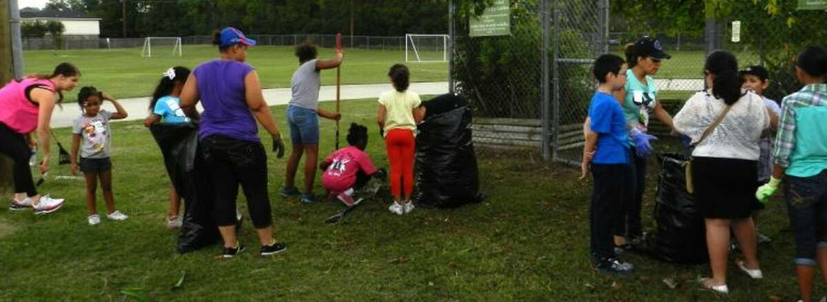 Faithbridge group and community work to improve the campus grounds.