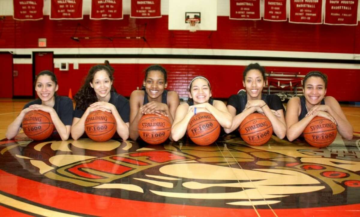 Not many championship banners have been added in the South Houston Lady Trojan Gym in recent years, but thanks to these six seniors fans are celebrating a co-district title this winter and the program is back in the playoffs for the first time in a decade. The six are, from left, Bianca Yanez, Bella Garcia, Brianna Butler, Jasmine Lopez, Akira Decoud and Dominique Davis. The playoffs open Monday night for the upstart Lady Trojans.