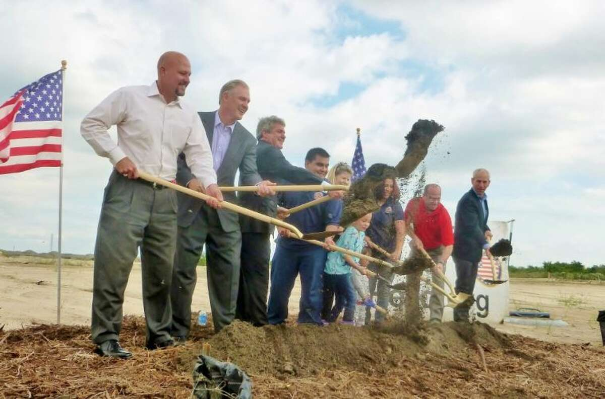 Officials break ground on the Olivares family's new home in Towne Lake.