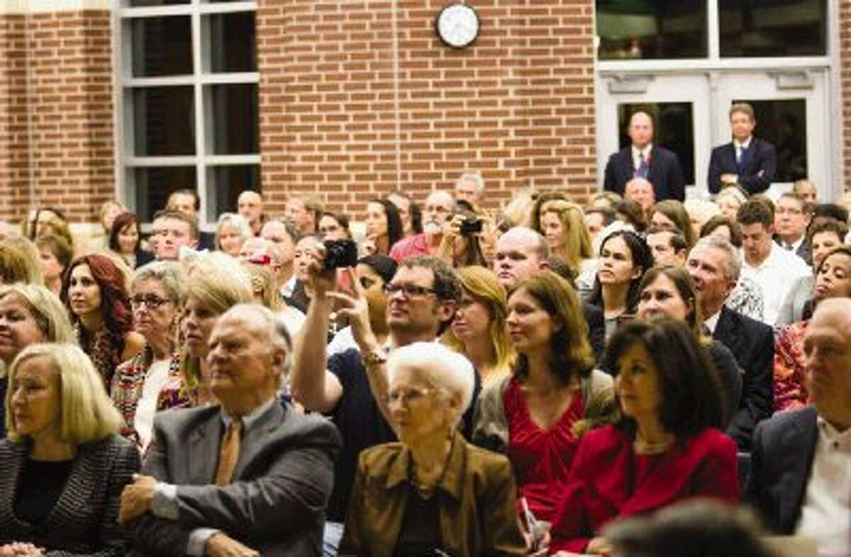 People gather at the Ann K. Snyder Elementary in The Woodlands Monday night to dedicate the new school to the woman it is named after. Ann K. Snyder, President and CEO of Interfaith of The Woodlands was honored by children singing and a video produced by her family and colleagues.