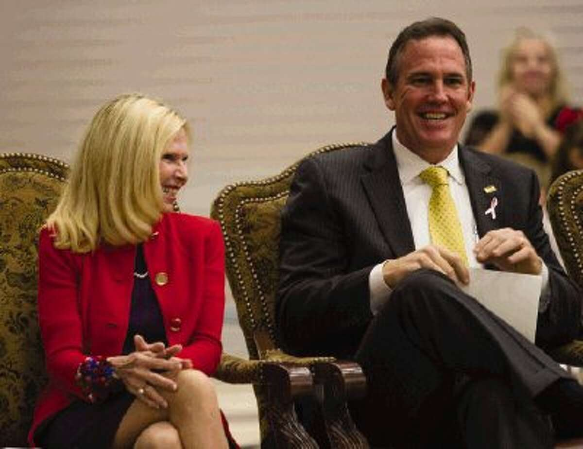 Ann K. Snyder, President and CEO of Interfaith of The Woodlands, and Conroe ISD superintendent Don Stockton sit together at Ann K. Snyder Elementary during an event in Snyder's honor. People gather at the school in The Woodlands Monday night to dedicate the new school to Snyder. During the night she was honored by children singing and a video produced by her family and colleagues.