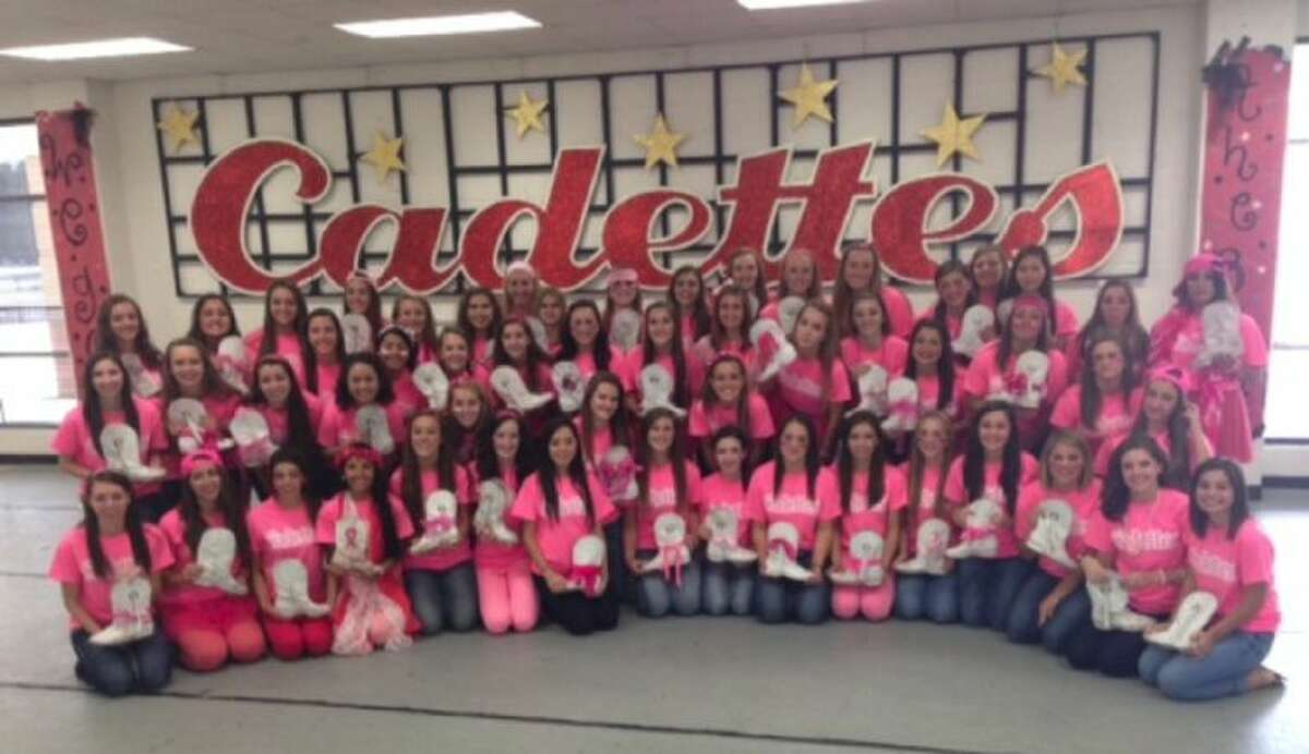 The Cypress Woods Crimson Cadettes drill team raised more than $3,000 to fight breast cancer through a