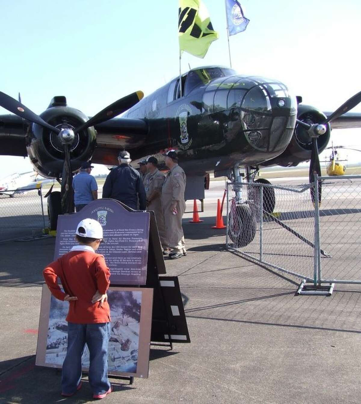The Disabled American Veterans Aviation Outreach Program at Wings Over Houston, featuring the Lone Star Flight Museum's B-25 (official B-25 of the Doolittle Raider Association) drew interest from people of all ages.