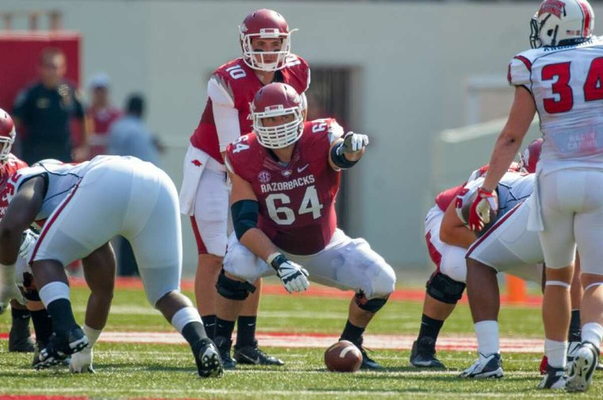 Kingwood grad Travis Swanson (64) has worked his way to being one of the nation's top centers. He's projected by ESPN.com to be first center selected in the 2014 draft.