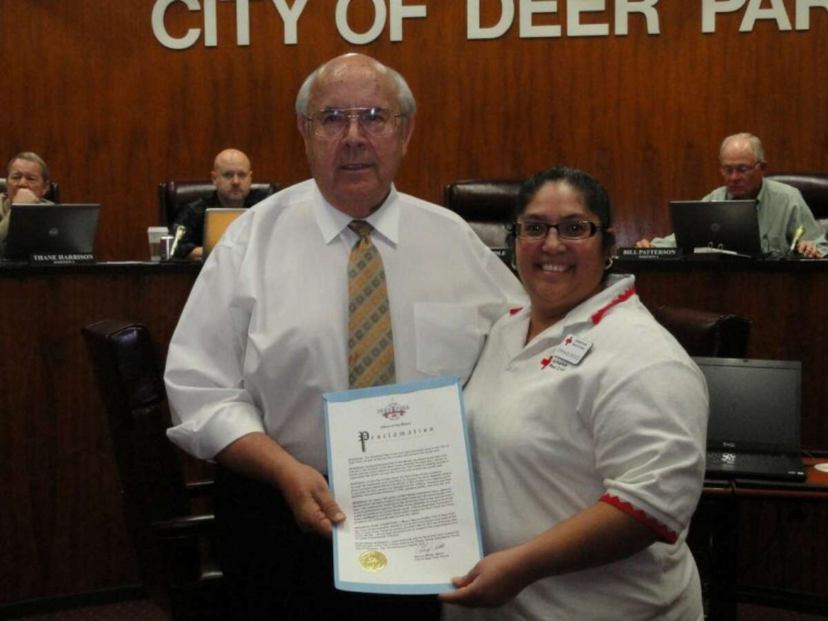 Deer Park Mayor Wayne Riddle presented a proclamation to the American Red Cross' Stephanie Orozco Tuesday night at city of Deer Park's council meeting.