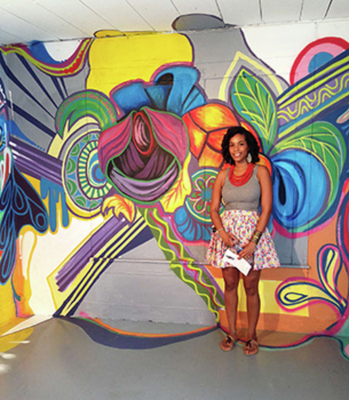 Cypress Lakes High School art teacher Lee Ann Carrier used a bright color palette to paint organic forms within a mural as part of the Project Row Houses exhibition