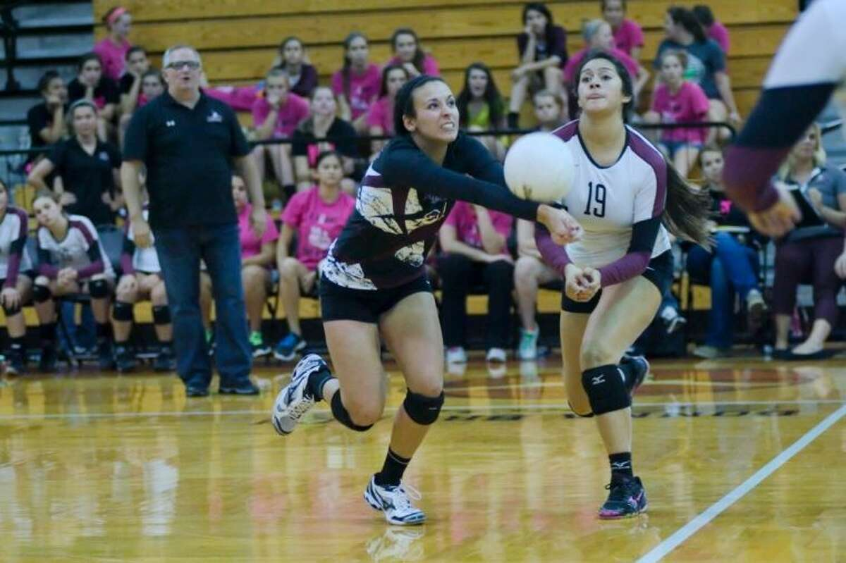 Pearland's Katarina Morton (21)stretches to make the set against Dobie Tuesday while teammate Alex Aguilera also converges on the ball.