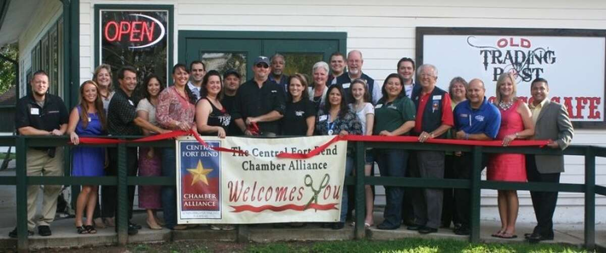 The Central Fort Bend Chamber Alliance recently conducted a ribbon cutting at Old Trading Post in Booth with Zack Wigley; Jennifer DeDear, Servpro of West Fort Bend County; Michele Barnes, QB Data; Tom Crayton, Thomas J. Crayton, CPA; Melissa Martin, Garcia-Martin & Martin; Lindsey Hollin, Old Trading Post; Lionel Martin, Garcia-Martin & Martin; Julia Raiford, Old Trading Post; Jason Glass, Old Trading Post; David Vogelsang, Old Trading Post; Tony Francis, Alicia Casias Agency - Nationwide Insurance; Becky Reeh, Old Trading Post; Eloise Lucas, Legacy Ford; Matt Ontiveros, Marriott Springhill Suites Rosenberg; Charlie Braun, bizINTOUCH; Sheena Navarro, Greenscape Associates; Blake Greer, Greer Wealth Management; Tom Wilson, Reading Road Self Storage; Cathy Pitts, SIG McDonald & Wessendorff Insurance; Ray Aguilar, Classic Chevrolet; Shanta Kuhl, Chamber President/CEO, and Gilbert Limones, First Victoria National Bank.