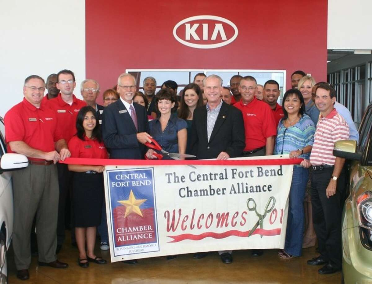The Central Fort Bend Chamber Alliance recently conducted a ribbon cutting at Fort Bend Kia in Rosenberg with (from left) From left: Charlie Moore, Fort Bend Kia; Carl Pierson, Fort Bend Kia; Geoffrey Alldred, Fort Bend Kia; Tom Wilson, Reading Road Self Storage; Yazmin Garcia, Fort Bend Kia; Lisa Matthews, Servpro of West Fort Bend County; Virgil Skinner, Fort Bend Kia; Jody Skinner, Fort Bend Kia; Katherine Skinner, Fort Bend Kia; Matt Ontiveros, Marriott Springhill Suites Rosenberg; Gil Velasquez, Fort Bend Kia; DeMorris Cox, Fort Bend Kia; Jim Theis, Fort Bend Kia; Roy Rangel, Fort Bend Kia; Alicia Casias, Alicia Casias Agency - Nationwide Insurance; Jason Griggs, Kevin Patton State Farm; Shanta Kuhl, Chamber President/CEO; Kevin Patton, Kevin Patton State Farm, and Tom Crayton, Thomas J. Crayton, CPA.