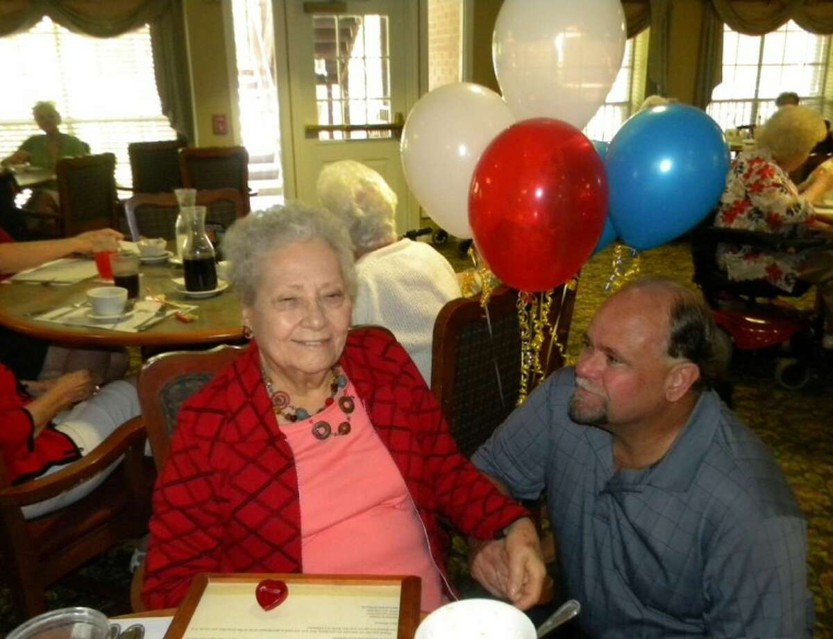 Edna Ames wins a trip to Washington, D.C., as part of the Wish of a Lifetime program. Her son, Steve Ames, surprises her at the Terrace at Willowbrook, where Ames lives.