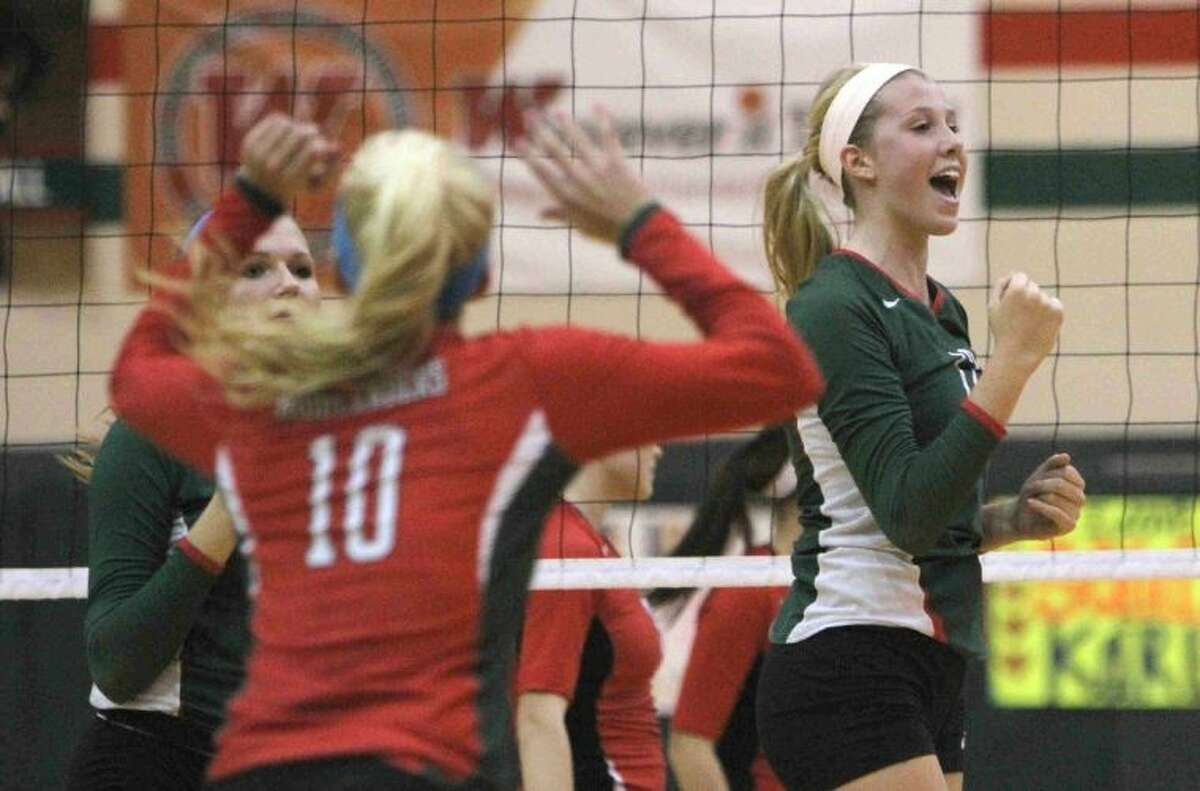 The Woodlands' Rachel Reed, right, celebrates a point during a match against Oak Ridge on Tuesday at The Woodlands High School. To view or purchase this photo and others like it, visit HCNpics.com.