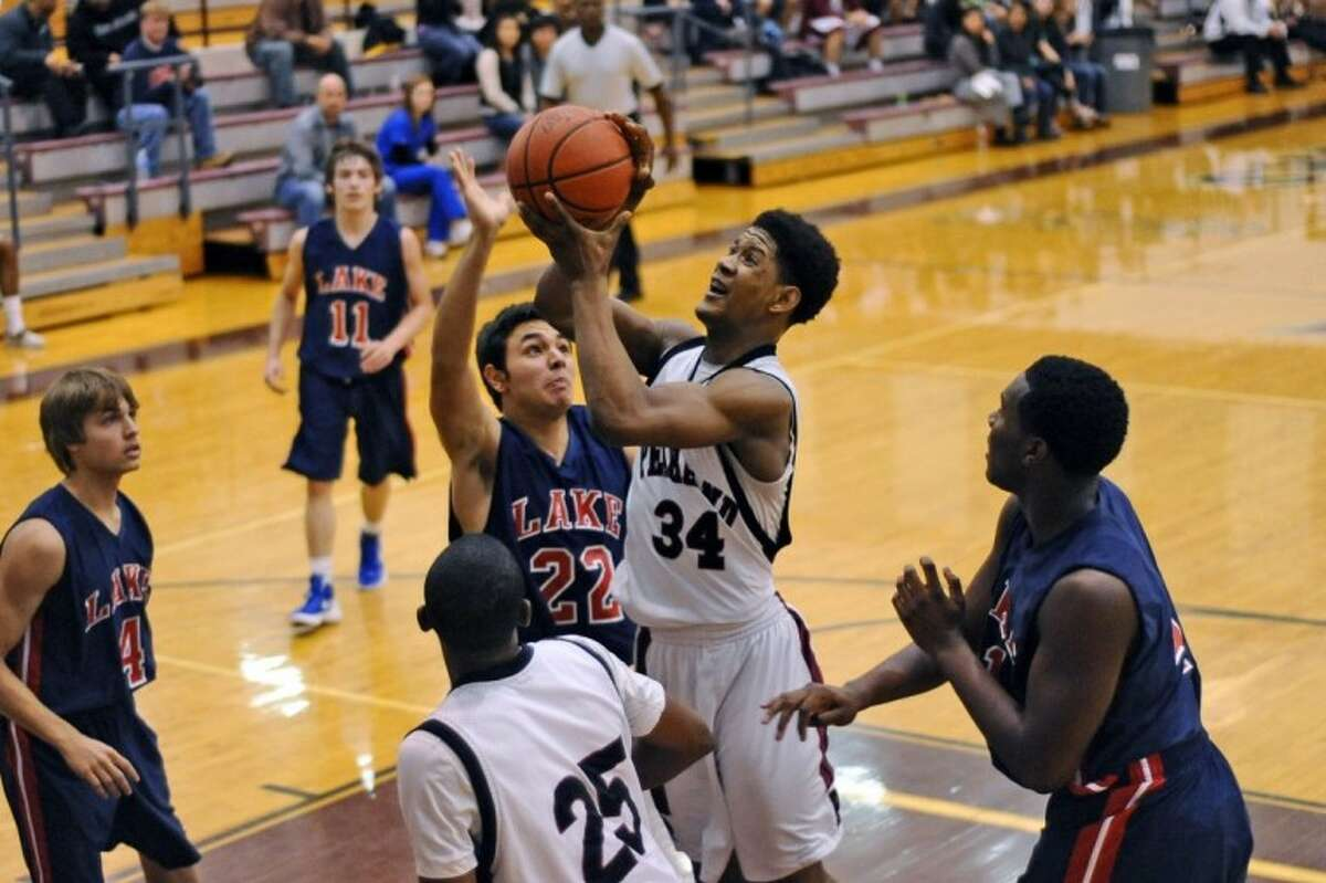 Pearland's Cameron Juniel (34) is a rebounding force and has drawn numerous charges as a defensive specialist for the Oilers.