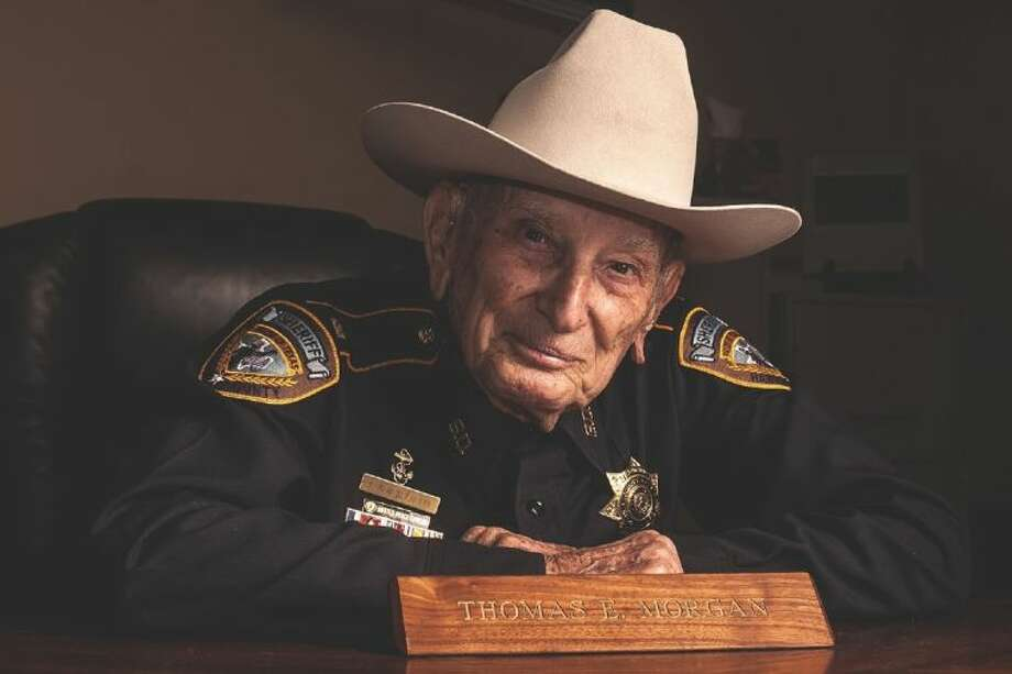 WWII veteran Thomas E. Morgan survived major battles in the South Pacific and eventually joined the Harris County Sherriff's office at the age of 72.