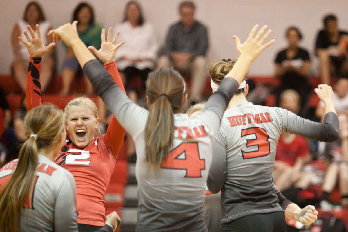 Huffman's Madi Wiggins (2) celebrates with her teammates after winning a point against Liberty on Oct. 29, 2013. (Photo by AMANDA J. CAIN/ The Observer)