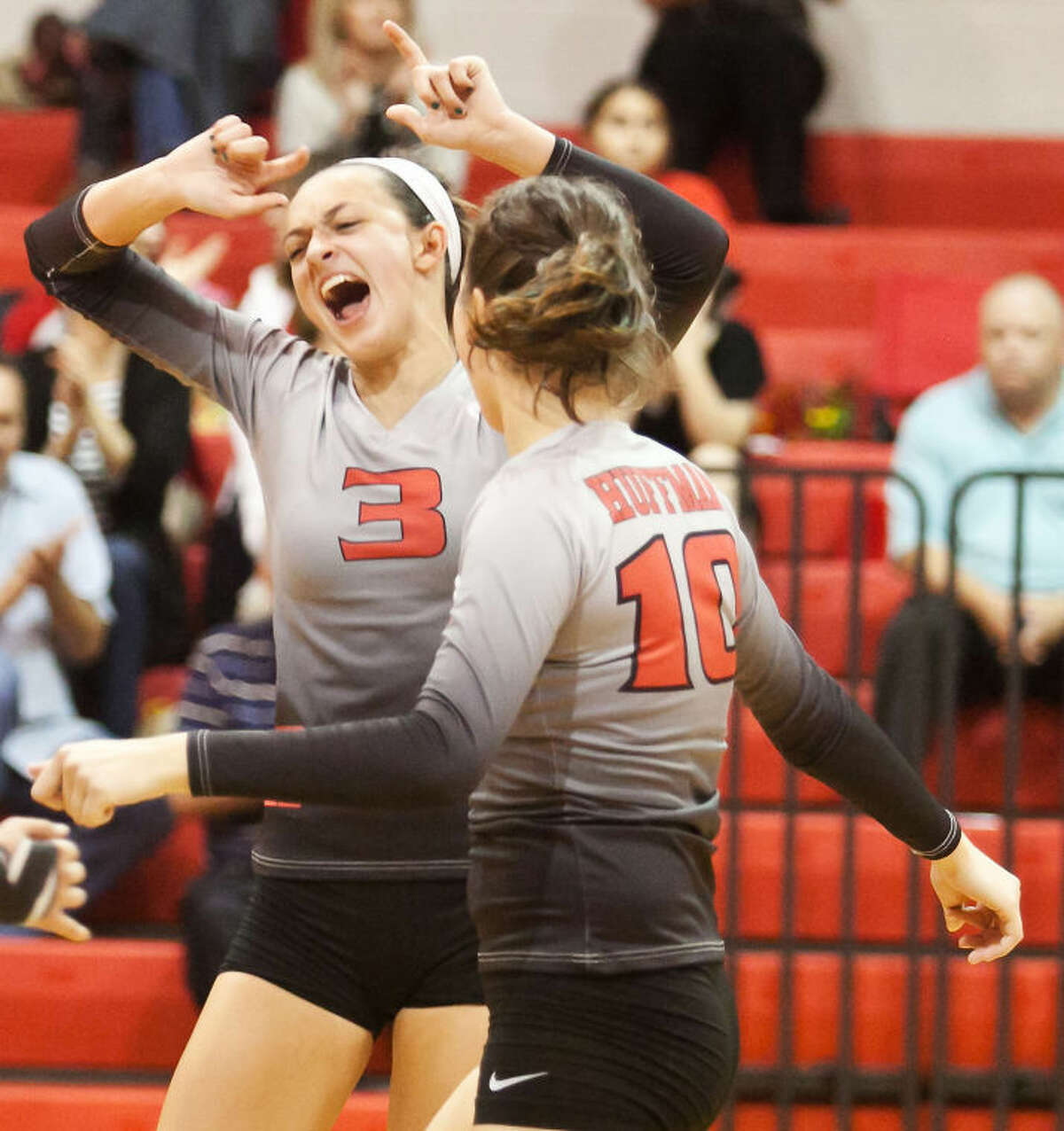 Huffman's Shelby Russell (3), celebrates after team inches closer to a win against Liberty. Huffman defeated Liberty in straight sets on Oct. 29, 2013. (Photo by AMANDA J. CAIN/ The Observer)