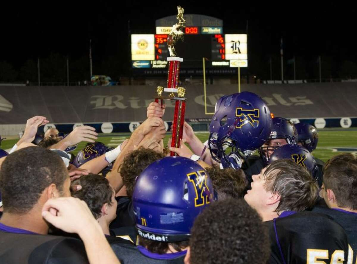 The Kinkaid football team holds up the Southwest Preparatory Conference South Zone trophy after they defeated St. John's, 35-15, Friday night at Rice Stadium to finish the regular season with a perfect 9-0 mark. The high-scoring Falcons will begin the SPC Big School playoffs Saturday night at home against the Episcopal School of Dallas, which was the fourth place team in the North Zone.