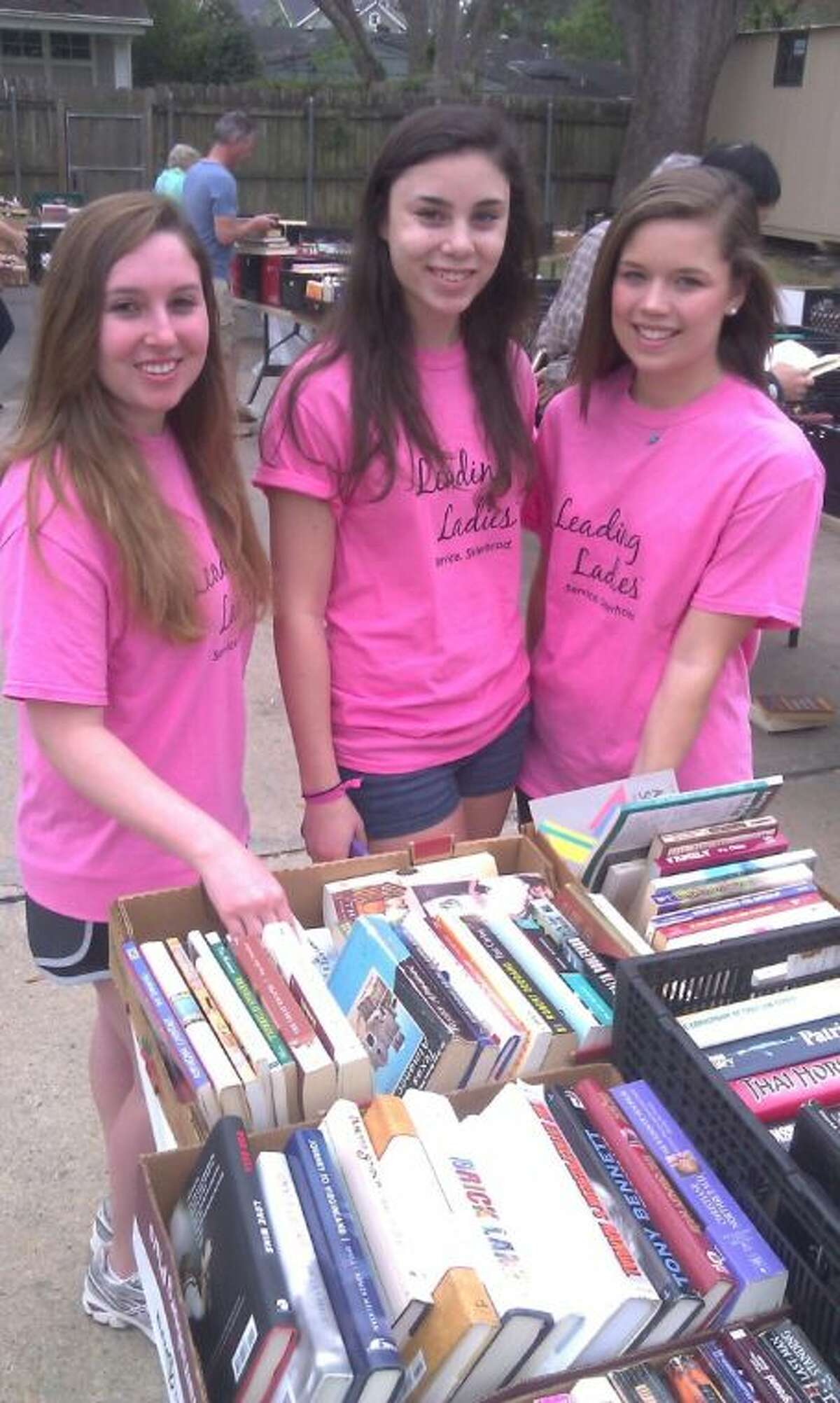 From left, Bellaire High School juniors and Leading Ladies members Julia Johnson, Hannah Brookner and Madeline Richardson are among volunteers helping the Friends of Bellaire Library gear up for bi-annual book sale,which will be held this Saturday, Nov. 2, from 9 a.m. to 4 p.m. at the Bellaire Library, 5111 Jessamine St.