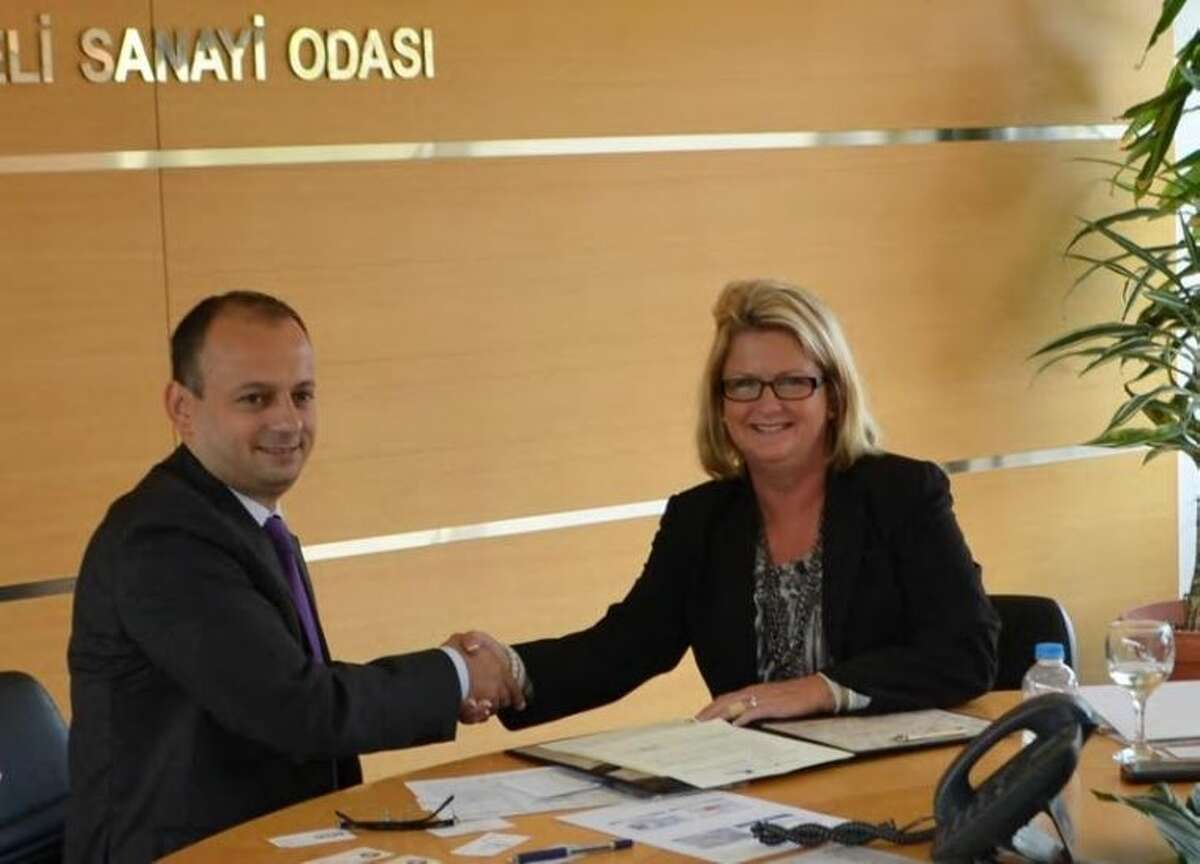 Kocaeli Chamber of Industry Secretary General, Memet Baris Turabi and President  CEO of the Fort Bend Chamber, Keri Schmidt.