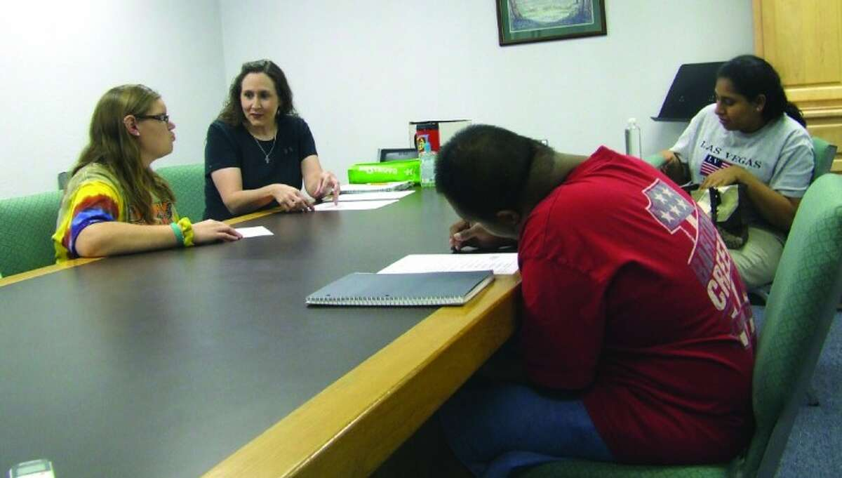 Tauna Kramer, second from left, teaches students about time managment during a class hosted by the Raj Hope Foundation at Living Waters Church. The class helps those over the age of 22 who are no longer in the public school system and wish to attend a local day program and interact with their peers.