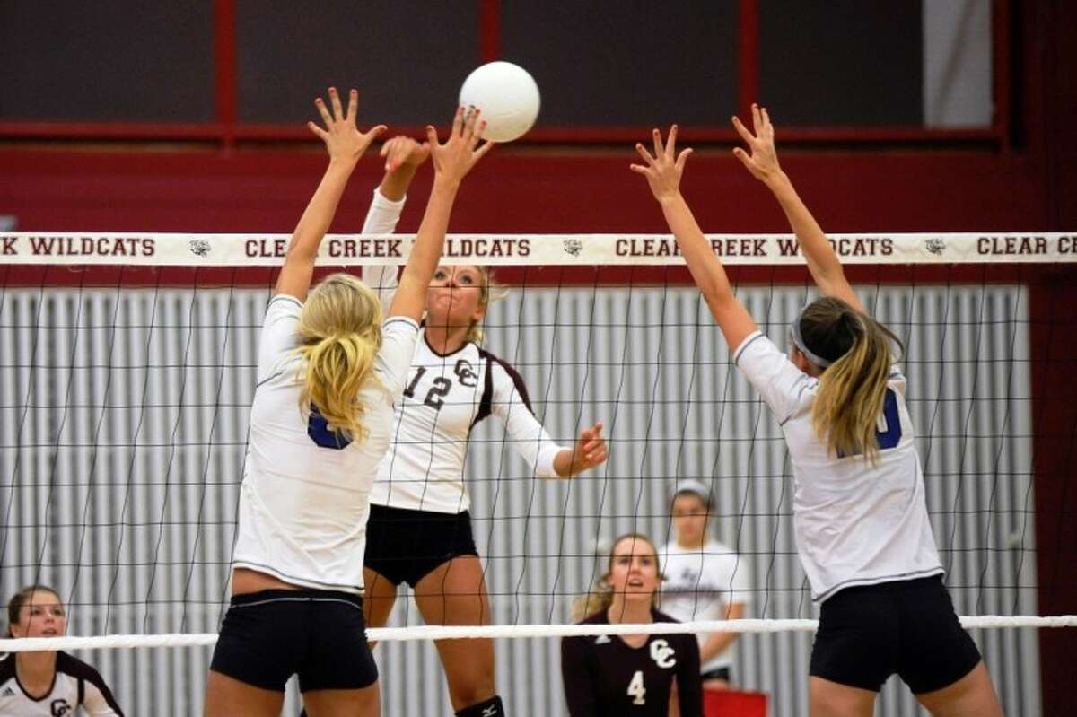 Ariel Froeschl (12) of Clear Creek, shown here in a match earlier this season, had nine kills and two blocks in helping lead the Lady Wildcats to a straight set win over Katy Tuesday night. Creek opens District 24-5A play Friday at rival Clear Lake.