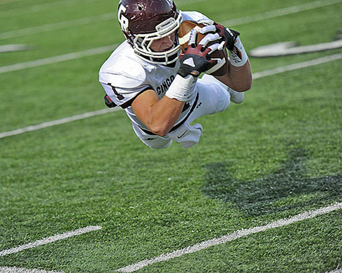 Cinco Ranch's Geryn Young makes a diving catch near the sideline during the Cougars' 28-14 win against Seven Lakes on Oct. 26 at Rhodes Stadium. Craig Moseley of PhotosbyMose.com offers a frame-by-frame look at the controversial catch.