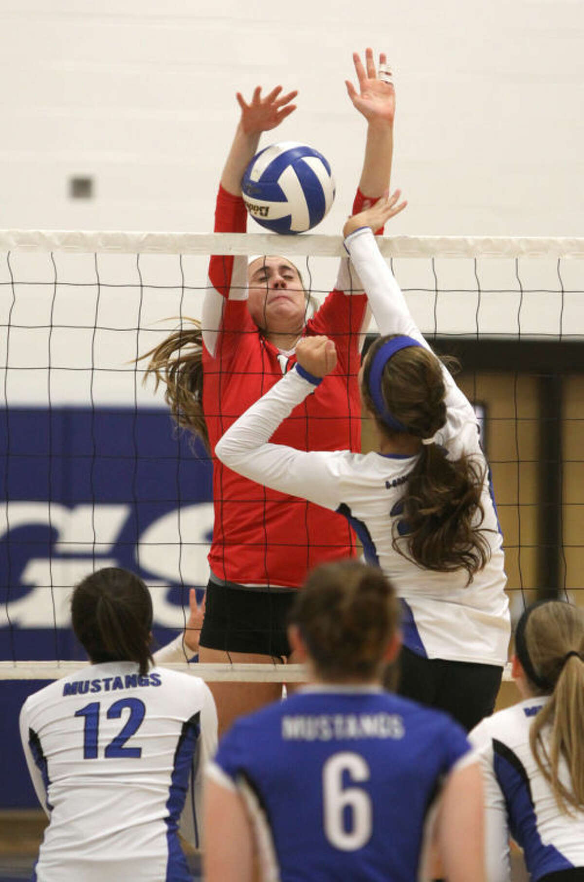 Katy's Zoe Hodges blocks against by Taylor's Allison Wallin during a District 19-5A match Oct. 15 at Taylor. To view or purchase this photo and others like it, go to HCNPics.com.