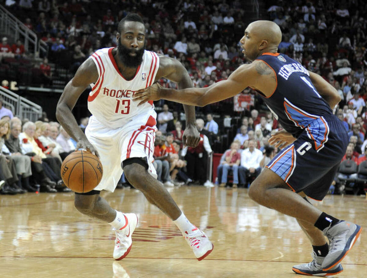 Houston Rockets guard James Harden drives around Charlotte Bobcats defender Gerald Henderson in the second half Wednesday in Houston.