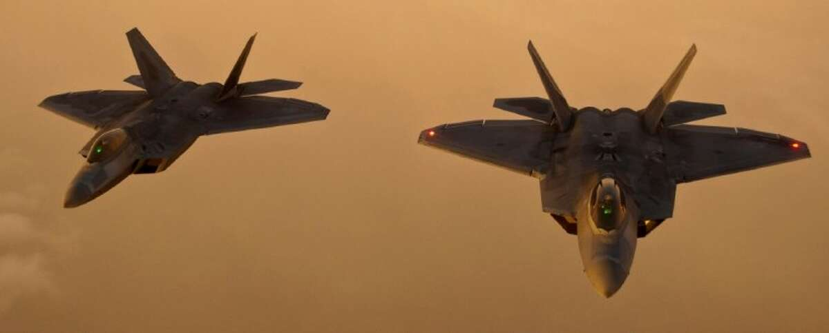 F-22 Raptors from Tyndall Air Force Base, Fla., fly in formation after an air refueling. A Raptor will be at the Wings Over Houston Airshow.