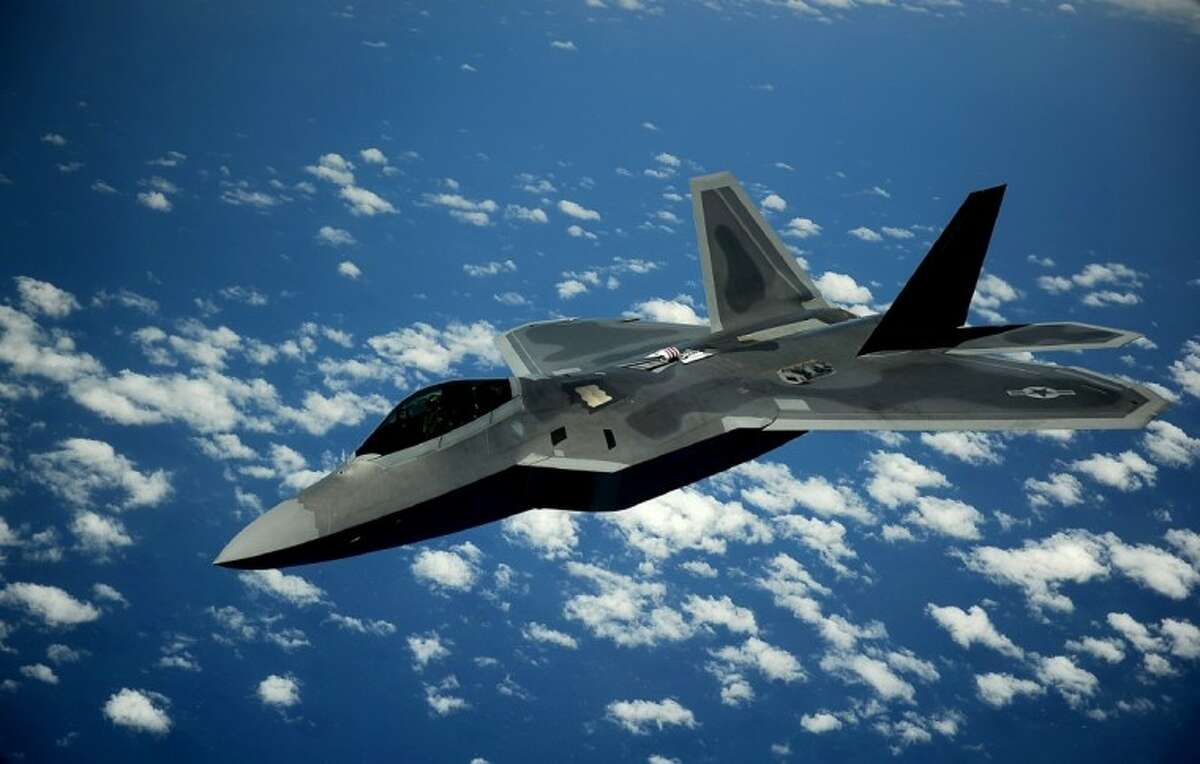 An F-22 Raptor pulls away from a KC-135 Stratotanker after refueling off of the East Coast on May 10, 2012. On Dec. 15, 2005, the Air Combat Command commander, along with the 1st Fighter Wing commander, announced the 27th Fighter Squadron as fully operational and capable to fly, fight and win with the F-22. The F-22 is with the 1st Fighter Wing at Joint Base Langley-Eustis, Va., and the KC-135 is with the 756th Air Refueling Squadron at Joint Base Andrews, Md. (U.S. Air Force photo/Master Sgt. Jeremy Lock)