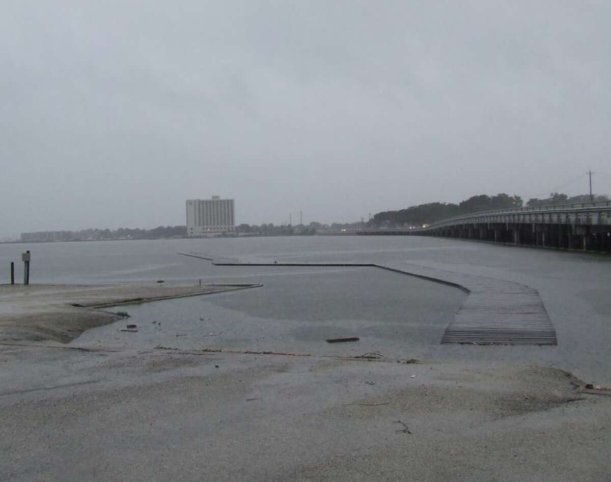 Clear Lake Park on NASA Parkway Thursday. The pier is almost under water.