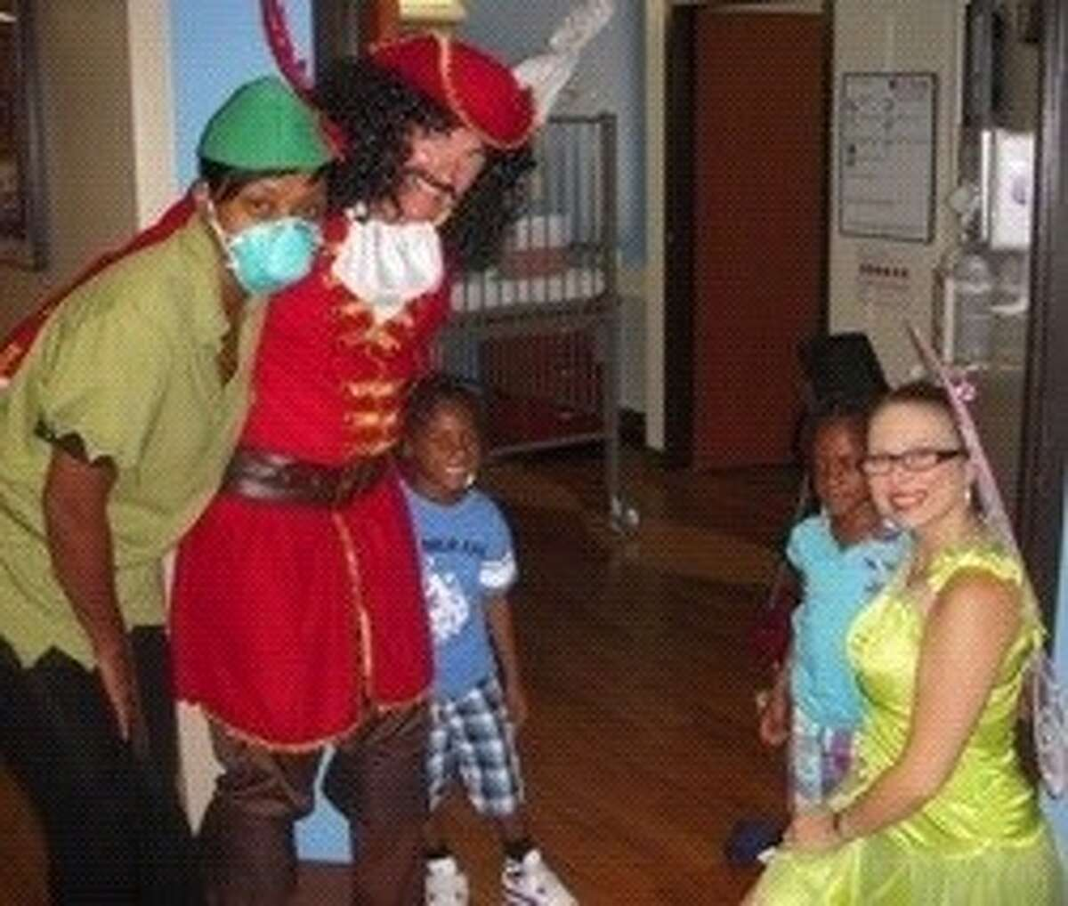 Express Employment Professionals in costume delivered decorated pumpkins to children in area hospitals for Halloween.