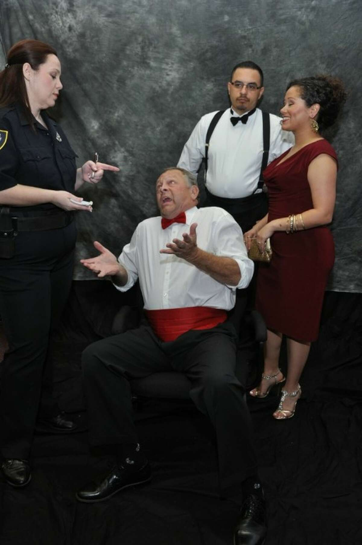 Officer Welch (Renea Runnels) questions guests Steve Quimby, Ralph Garza and Samantha Salazar in