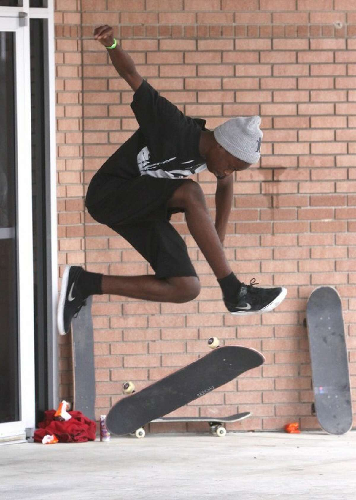 Kevin Storm 14, practices his moves while riding his skate board with the TruthRiders.